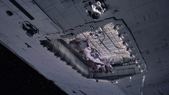 Leia's ship being pulled into the Star Destroyer's docking bay.