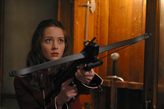 Fred aiming a crossbow on the TV show Angel.