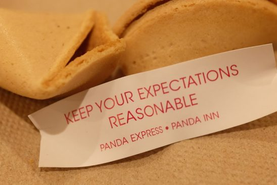 "A fortune cookie slip that reads ""keep your expectations reasonable."""