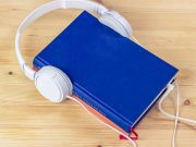 A book wearing a pair of headphones