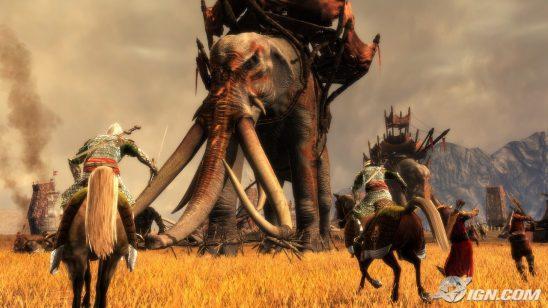 A screen shot of a LotR video game showing cavalry charging a giant elephant.