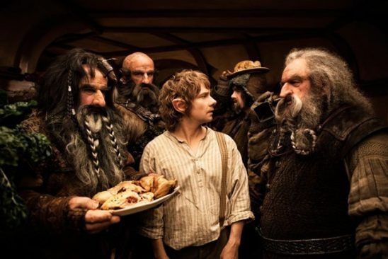 Dwarves with plates of food in The Hobbit