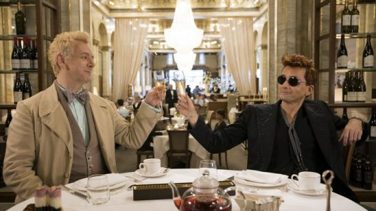 Crowley and Aziraphale drink champagne at a nice restuarant.