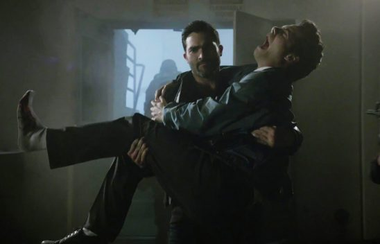 Derek carries a howling Stiles in a bridal carry