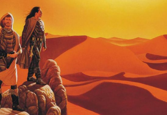 Three robed characters looking out over the Arakis desert.