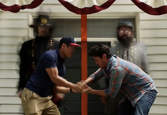 Two men fight with two ghosts in Civil War uniforms behind them