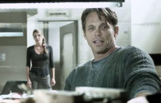 In The 100, Jake is recording a video to expose a government secret when his wife sees him.