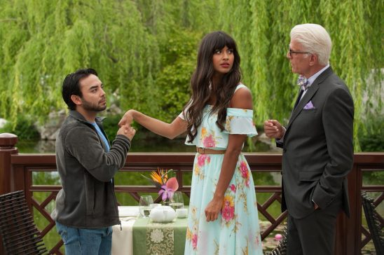 In The Good Place, Tahani looks unhappy as a short man holds her hand to kiss it.
