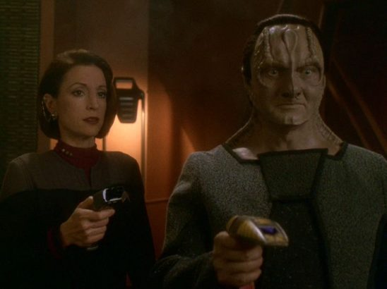 Kira and Garak with phasers in hand.