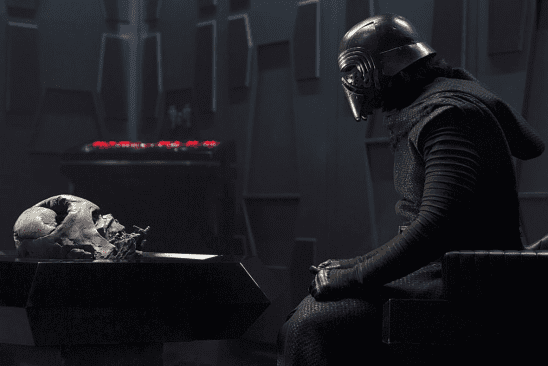 Kylo sitting across from Darth Vader's mask.