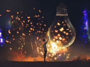 A boy surrounded by glowing butterflies looks at the ones inside a giant lightbulb
