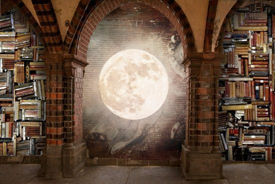 A moon on the wall of a library.